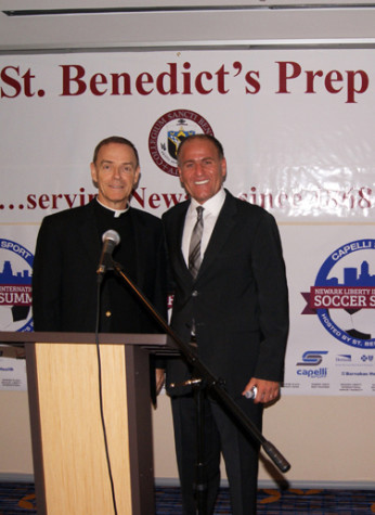 Headmaster Rev. Edwin Leahy, left, stands with CEO of Capelli Sport, George Altirs, right.