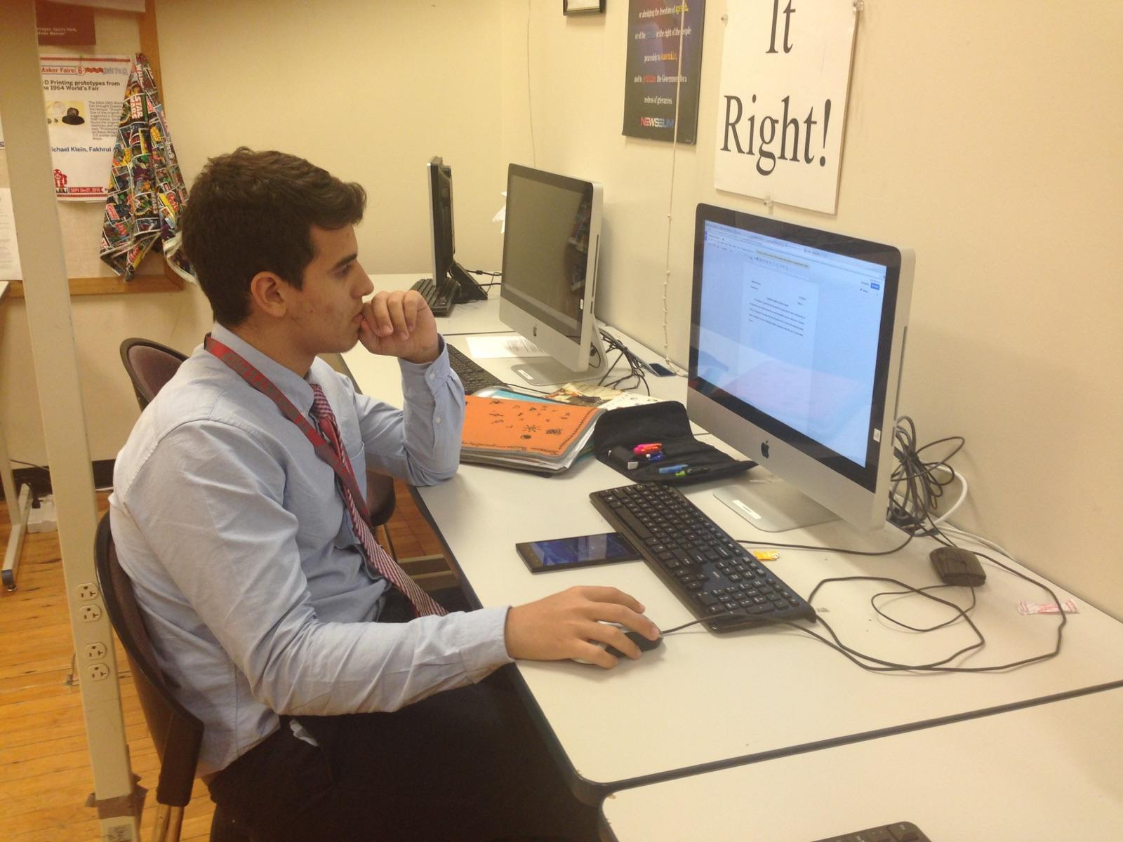Above, UDII Jefferson Pereira completes work while wearing an atypical school outfit of shirt and tie. Jefferson supports this silent protest.