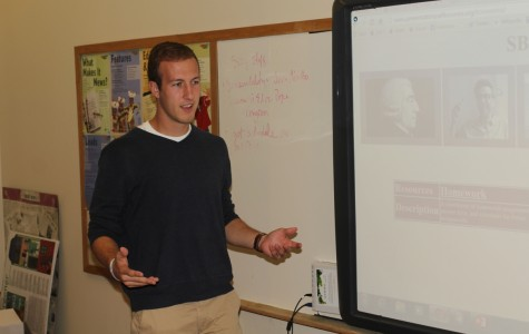 Above, Chris Heitzig teaches his economic class. He is already engaged with several parts of the school.