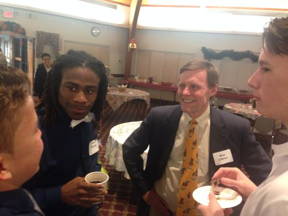 Michael O'Brien, who organized the banquet for Leahy House students, mingles with UDIIs Nicholas Black, Dayln Woody and Micheal Periera (from left to right).