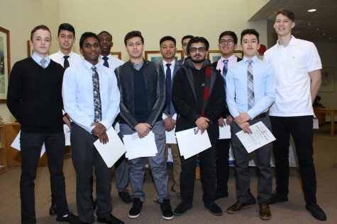 Eleven students were inducted into the NHS in the Radel Library.