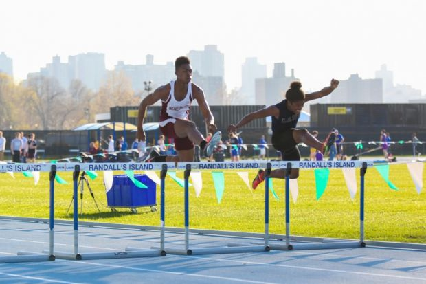 Senior Magnum Phelps hurdling at NY Relays. He finished second running 55.94 seconds.