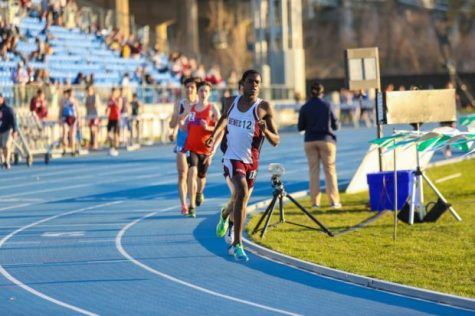 Freshman Ronald Kigen on the final lap of the 3200-meter run. He finished the race running 9 minutes and 37 seconds.