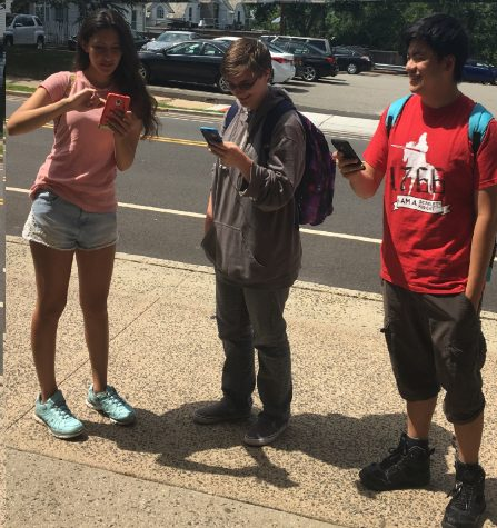 Rutgers students hunt for Pokemon outside the School of Communications.