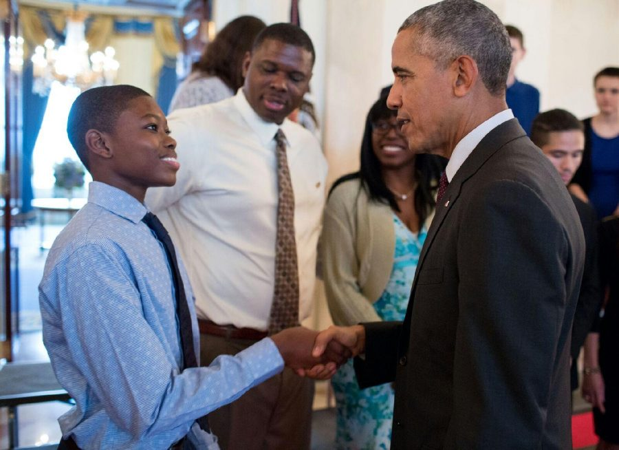 Freshman Ammon Moore Jr. shaking the hand of President Barack Obama at the President's Volunteer Service Award reception.