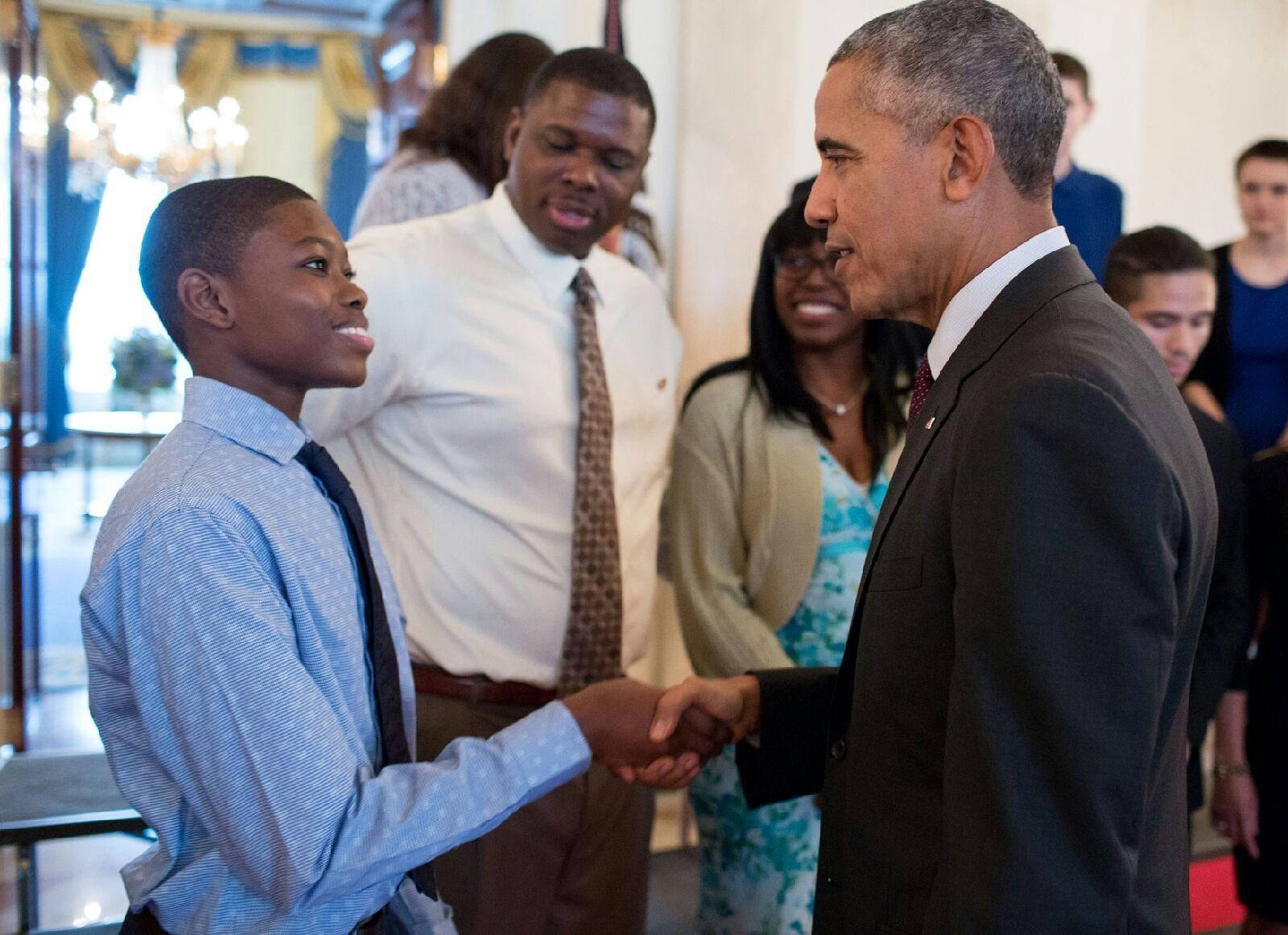 Freshman Ammon Moore Jr. shaking the hand of President Barack Obama at the President's Volunteer Service Award reception.