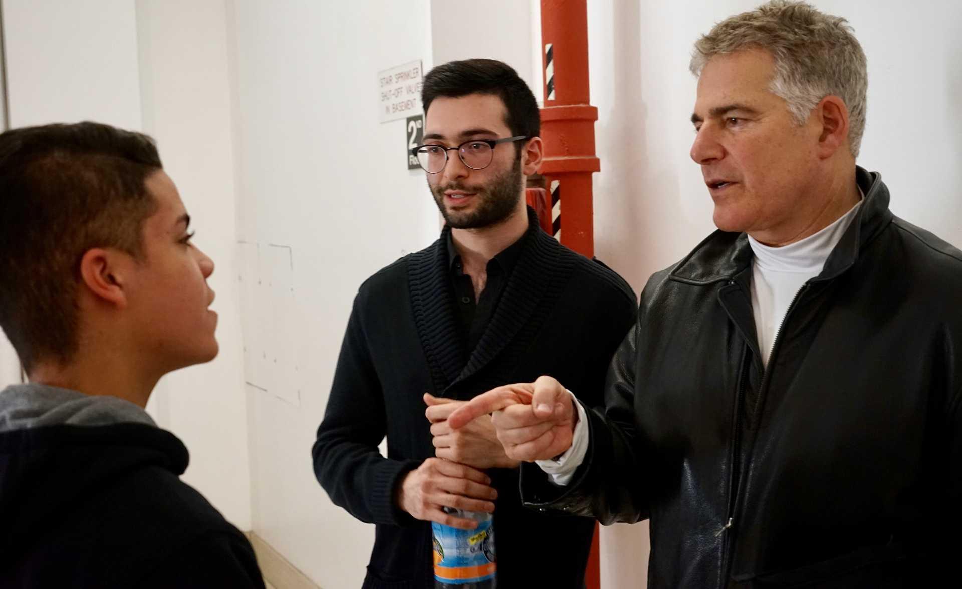 Stephen Adubato's father Steven Adubato Jr. speaks with Nathaniel Cruz at the New York Encounter, January 14.