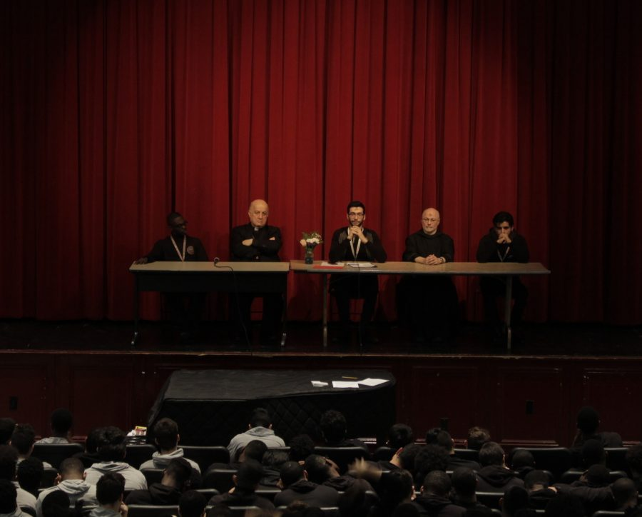 The St. Benedict's Prep. community listening to the panel consisting of Senior Faseeh Bhatti, senior Justin Dickerson, Br. Maximilian Buonocore, O.S.B. and Bishop Yousef Habash of the Syriac Catholic Eparchy..