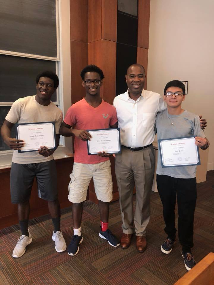 Syracuse University Professor Jeff Mangram (third from left) celebrates completion of the summer program with SBP Seniors (from left) Wood-May Joseph, Jules Gouton, and Juan Perez.