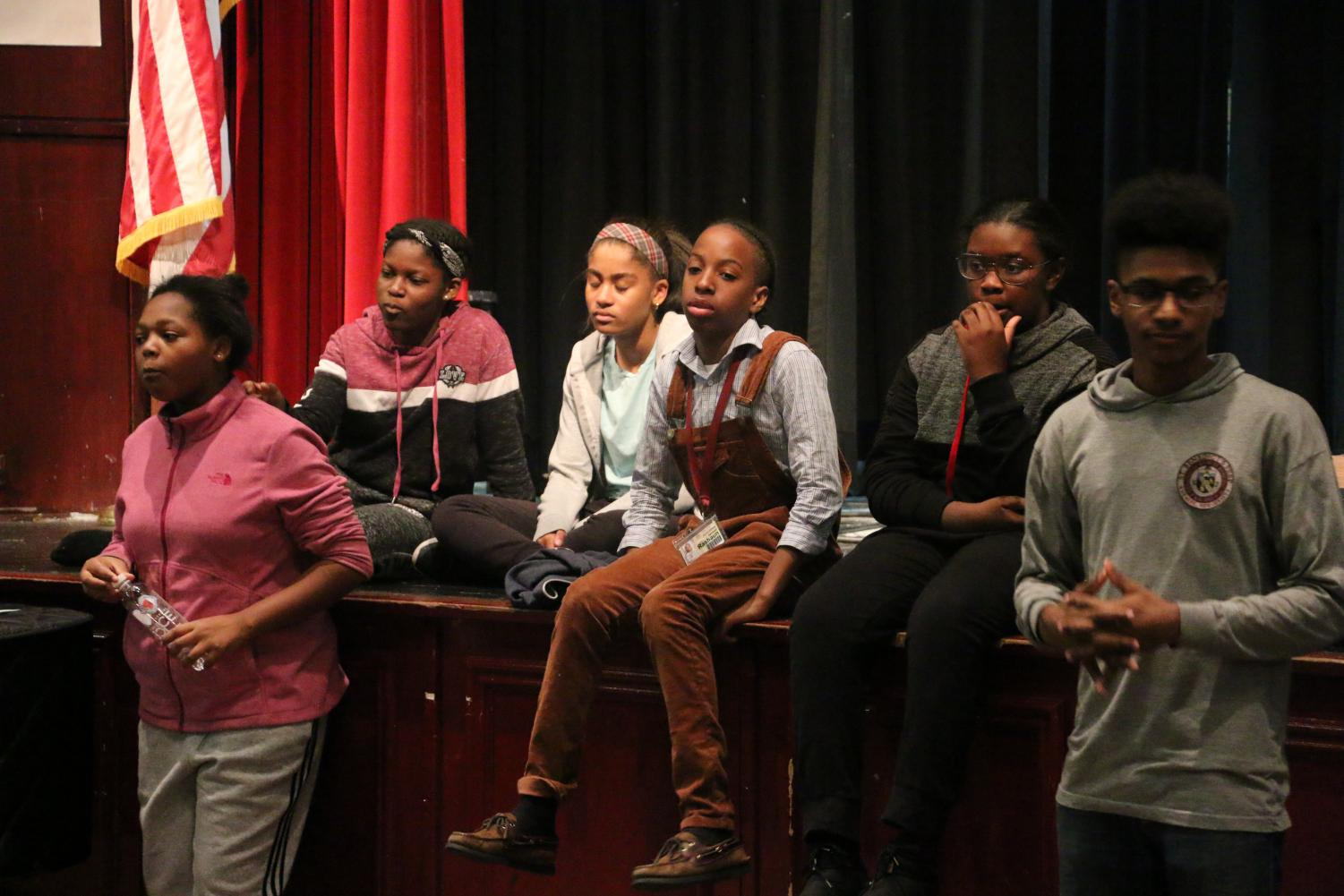 An ensemble of SBP students practice for the Drama Guild's latest production.
