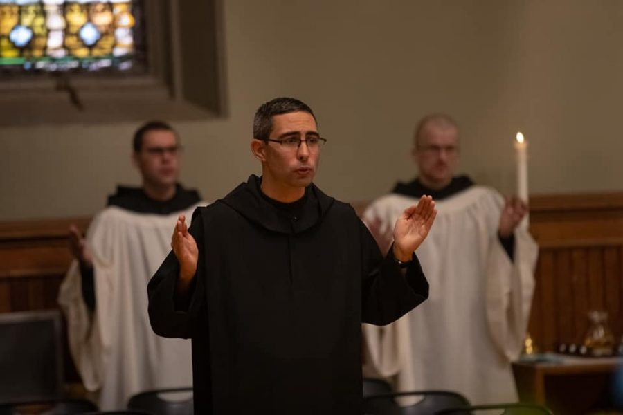 In professing his simple vows, Br. Mark joins a number of young monks in Newark Abbey.