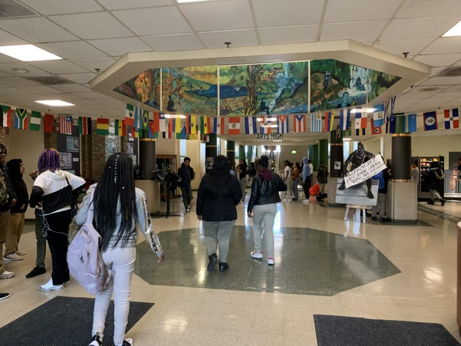 Arts High School students take a breath of relief after a message over the intercom allowed them to go home.