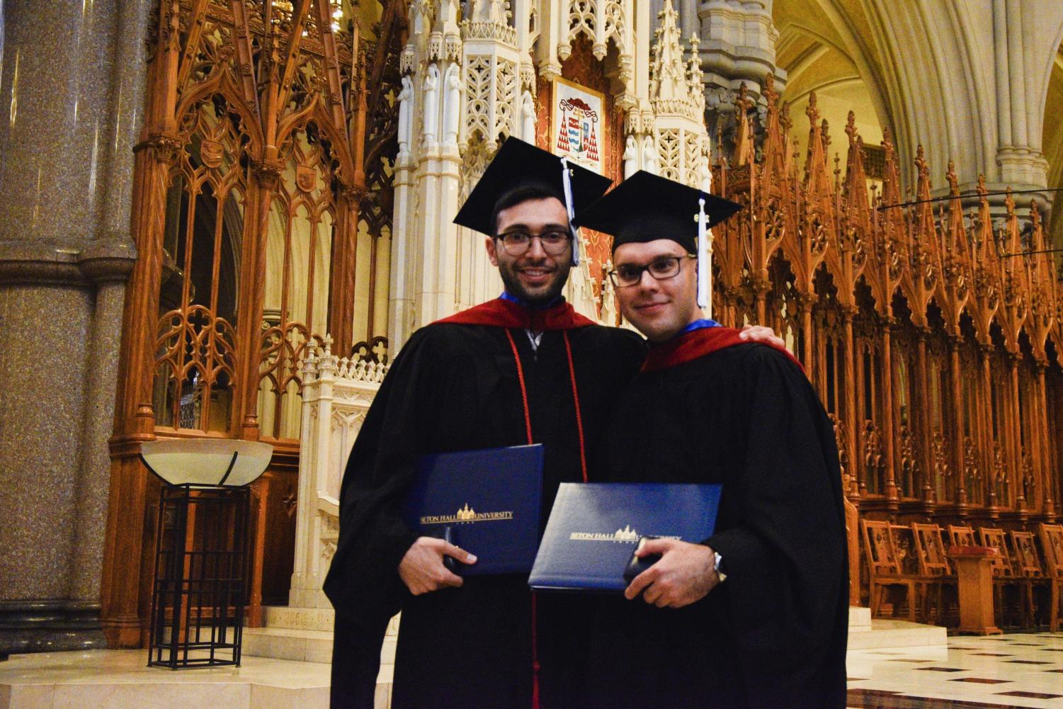 Mr. Stephen Adubato (left) and Br. Asiel Rodriguez celebrate after receiving Master's degrees and academic medals in a ceremony at the Cathedral Basilica in Newark.