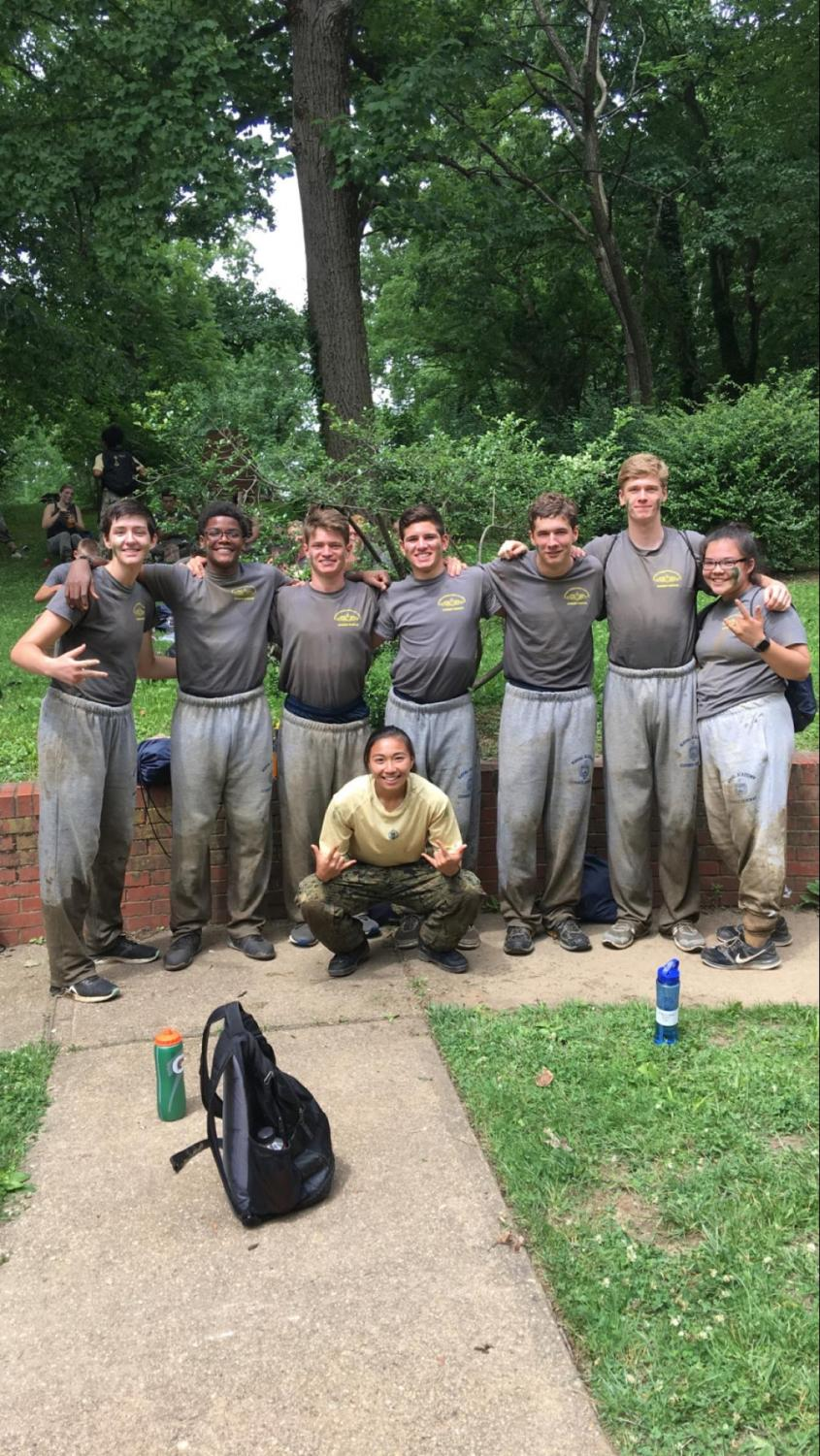 SBP Senior Seun Eisape (second from left) participates in a one-mile-long obstacle course in the woods with his squad.
