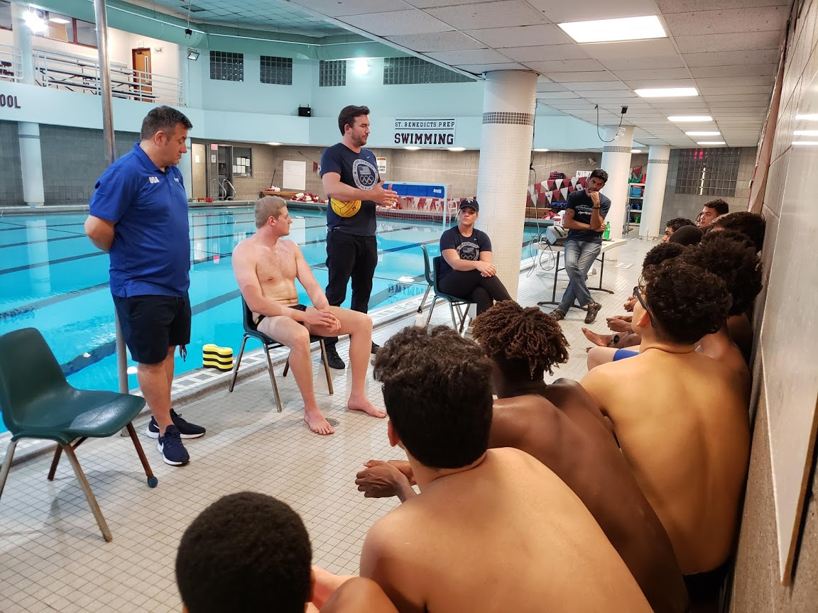 SBP's Water Polo Team is treated to some Olympian expertise during a training clinic. (From left) Olympics Coach Dejan Udovicic and U.S. Water Polo Olympians Thomas Dunstan, John Mann, and Kami Craig talk technique and winning attitude to the Gray Bees.
