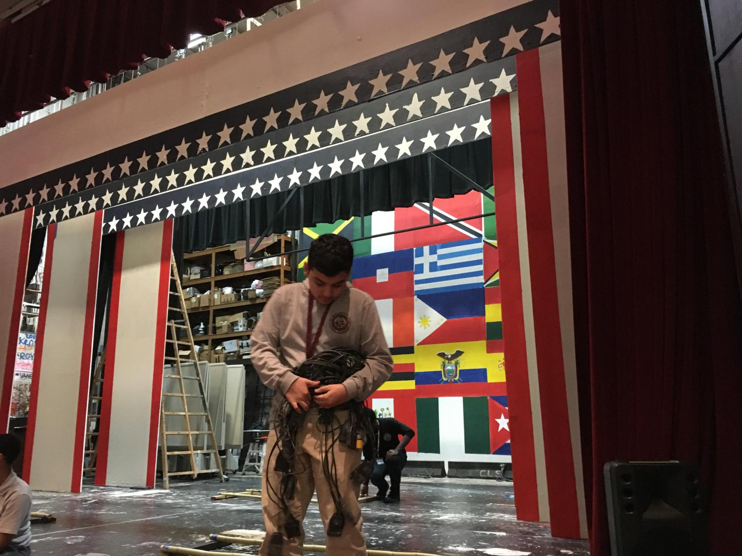 Adrian Vasquez UDI and other tech crew members of the SBP Drama Guild making some final touches to the set of the upcoming play.