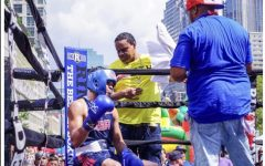 Happier Days: Keith Colon, seen mid-bout, at the 60th Annual Puerto Rican Heritage Festival in Jersey City in August. Colon, a nationally ranked amateur boxer, won the match.