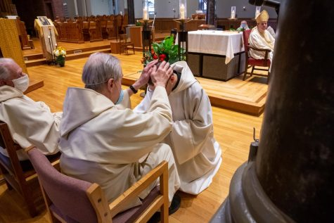 Newark Abbey Abbot Melvin Valvano, O.S.B., blesses Br. Asiel Rodriguez, O.S.B, in the Diaconate Ordination ceremony.